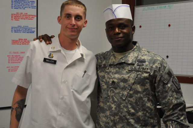 FORT LEONARD WOOD, Mo. – LEFT: Pfc. Joshua Miller, a food service specialist, and Staff Sgt. Bradley Williams, a food service specialist both assigned to 4th Maneuver Enhancement Brigade Headquarters and Headquarters Company, complete debriefing in the Tony's Place dining facility administrative office August 11.