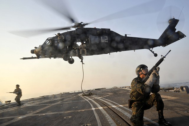 Members of Fuerza de Operaciones Especiales, Peru special operations force, fast rope from a UH-60 Black Hawk helicopter operated by the Army 160th Special Operations Aviation Regiment onto the flight deck of the guided-missile frigate USS Carr as part of PANAMAX 2010. Special operations forces from Peru, Colombia, Brazil and Panama trained alongside East Coast based Navy SEAL operators as part of the 12-day exercise simulating a multinational effort to defend the Panama Canal.