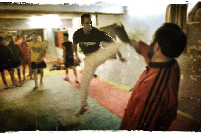 Nagib Mohammadi packs a powerful kick while practicing kickboxing with his trainer in an Afghanistan gym in Kabul