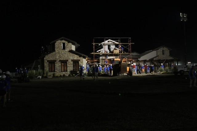 """Volunteers work around the clock to finish building a house in Ottawa, Kan., for a Kansas National Guardsman who has PTSD. Around 400 volunteers in conjunction with """"Extreme Makeover: Home Edition"""" built the house in a week. The episode is scheduled to air in October."""