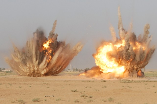 CONTINGENCY OPERATING SITE WARRIOR, Iraq – Soldiers from 'Chaos' Company C, 1st Special Troops Battalion, 1st Advise and Assist Task Force, 1st Infantry Division, detonate C-4 explosives during Engineer Core Demolition Task Training at a demolitions range outside of Contingency Operating Site Warrior, Iraq, Aug. 11, 2011. The unit used the explosives to remove obstacles, destroy fortifications, and breach doors.