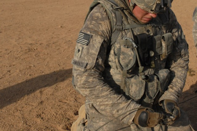"CONTINGENCY OPERATING SITE WARRIOR, Iraq – Specialist Michael Chiumiento, a combat engineer from Winthrop, Mass., assigned to 'Chaos' Company C, 1st Special Troops Battalion, 1st Advise and Assist Task Force, 1st Infantry Division, links together a C-4 plastic explosive block during Engineer Core Demolition Task Training at a blast range outside of Contingency Operating Site Warrior, Iraq, Aug. 11, 2011. ""Even at his skill level, he should learn how to prime a charge and set-up the firing systems,"" said 1st Sgt. Harold Cole Jr., Chaos' senior enlisted Soldier, as he gestured toward Chiumiento."