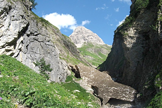 A tongue of dirt-encrusted glacier hangs above a river in Austria's Lechtal mountains. While glacier travel in remote areas requires specialized equipment and expertise, the E-5 hiking path skirts the dangerous areas to allow its travelers to get close to real mountain environments while avoiding treacherous situations.