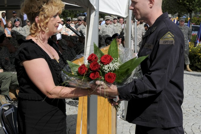 Command Sgt. Maj. Frank Graham's spouse, Elke Graham, receives flowers during her husband's change of responsibility ceremony at the Joint Multinational Readiness Center in Hohenfels, Germany on August, 12, 2011. (U.S. Army photo by Pfc. Paul Sale)