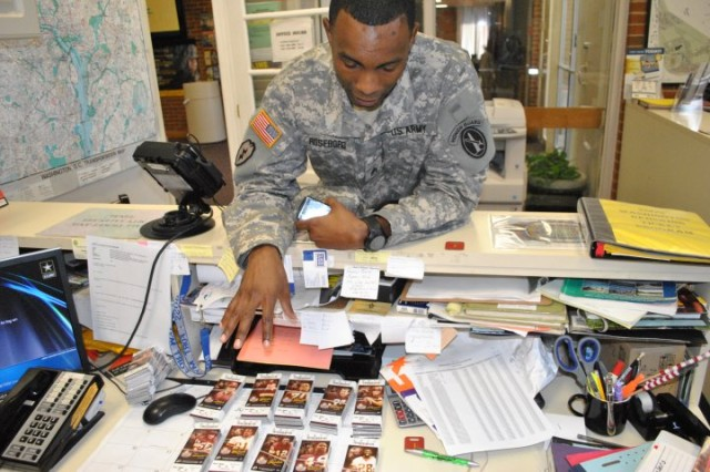 Old Guard Staff Sgt. Robert Roseboro tries to decide which tickets to purchase during the opening day of NFL ticket sales on Joint Base Myer-Henderson Hall. Photo By Jim Dresbach.