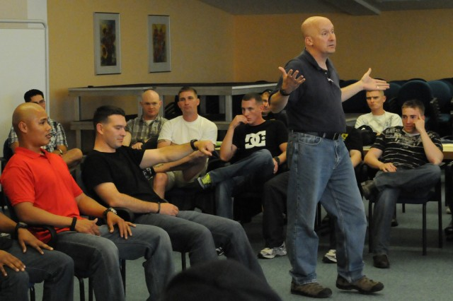 Maj. Glen Wurglitz, an Army Reservist with 785th Medical Company and an instructor for Soldier 360°, a leader comprehensive fitness course for junior and senior noncommissioned officers, demonstrates how hypnosis can complement a Soldier's treatment plan.