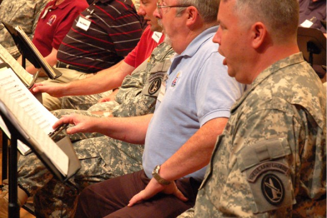 Current and former members of the Army Chorus, a component of The U.S. Army Band, rehearse together in Brucker Hall Aug. 5 on Joint Base Myer-Henderson Hall in preparation for several concerts recognizing the vocal ensemble's 55th anniversary.