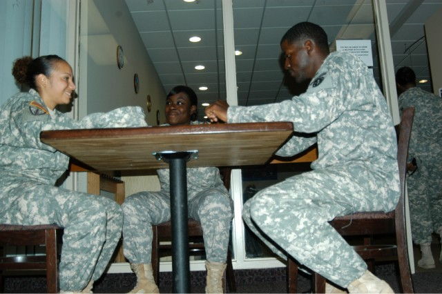 Staff Sgts. Megan Garcia, Tevishiah Dinkins and Terrell Moorer take a break at Joint Base Myer-Henderson Hall's Community Center. Besides being used as a meeting place, Soldiers can use the computer and rec rooms as well as picking up discounted tickets to many District of Columbia attractions.