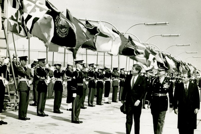 """Murray walks in between President Kennedy, left, and Brazilian President Joao Goulart during a review of troops April 3, 1962. Murray was the commander of the 3rd Infantry Regiment, known as """"The Old Guard."""" As the Army's official ceremonial unit, one of its duties is to escort the president."""
