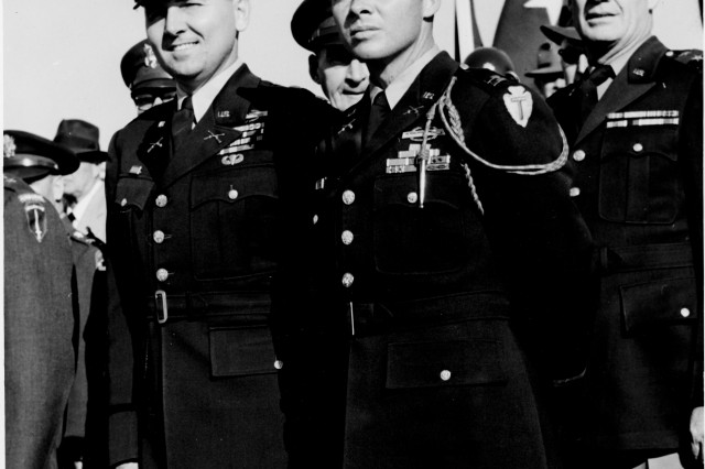 Murray, left, stands along Audie Murphy, pictured here as a captain, at Fort Benning, Ga. Murphy is the most decorated veteran of World War II.