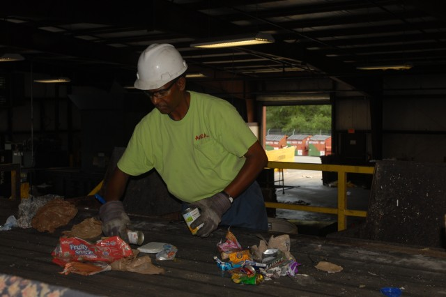 Another important separation stage is done by Claude Moore at the RRC. Moore is one of several employees who separates cans, plastics, paper and places them in containers.