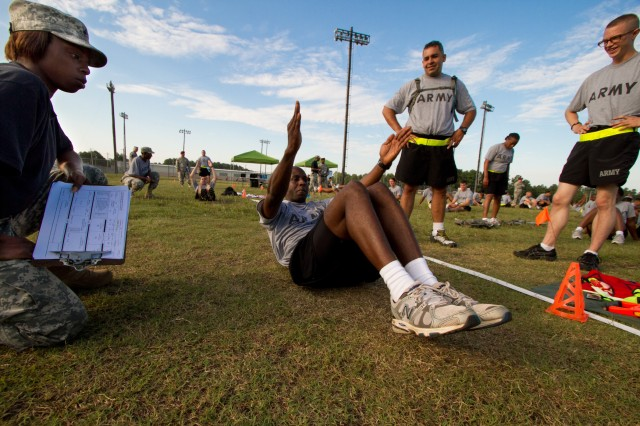 First Sgt. Delarick Williams, a paratrooper with the 82nd Airborne Division's 1st Brigade Combat Team, completes seated rows for the new Army Physical Readiness Test Aug. 10, 2011, at Fort Bragg, N.C.  Rows are replacing the sit-up as a test of abdominal and core-muscle strength and endurance.  (U.S. Army photo by Sgt. Michael J. MacLeod)