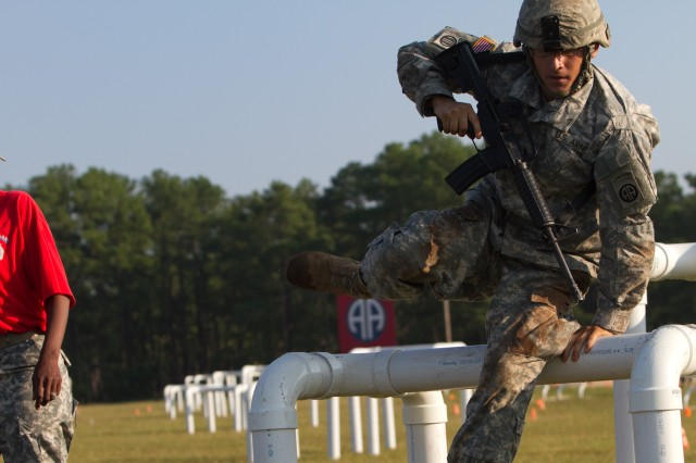 A paratrooper with the 82nd Airborne Division's 1st Brigade Combat Team negotiates an obstacle during the new Army Combat Readiness Test Aug. 17, 2011, at Fort Bragg, N.C.  The test is being administered to several thousand soldiers across the Army to determine what the new standards should be.  (U.S. Army photo by Sgt. Michael J. MacLeod)
