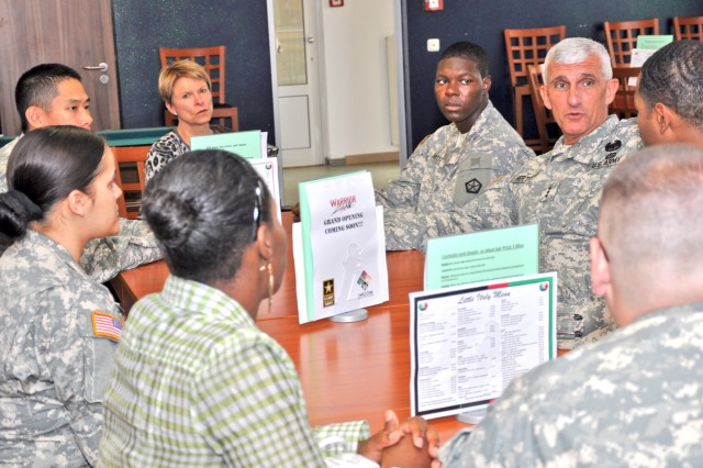 Lt. Gen. Mark Hertling, U.S. Army Europe commander, brainstorms with members of Wiesbaden's Better Opportunities for Single Soldiers during a visit Aug. 12.