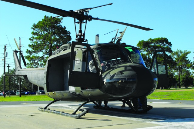 The UH-1 Huey awaits its cargo of Airborne Soldiers from the Joint Readiness Training Center and Fort Polk Command Group before its last official mission Aug. 4.