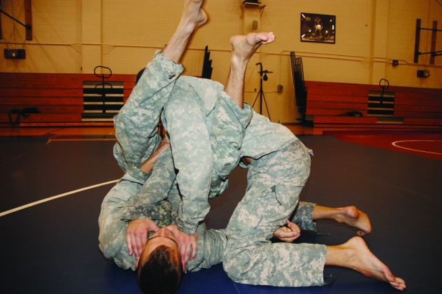 Two unidentified Soldiers mix it up during combatives training at the 1st MEB gym Aug. 10.