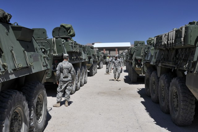 Soldiers from 1st Battalion, 23rd Infantry Regiment, 3rd Stryker Brigade Combat Team, 2nd Infantry Division, line their Stryker armored fighting vehicles up for the installation of the Multiple Integrated Laser Engagement System. More than 300 Strykers were transported from Joint Base Lewis-McChord, Wash., to NTC for the approximately month long training exercise in the California desert.