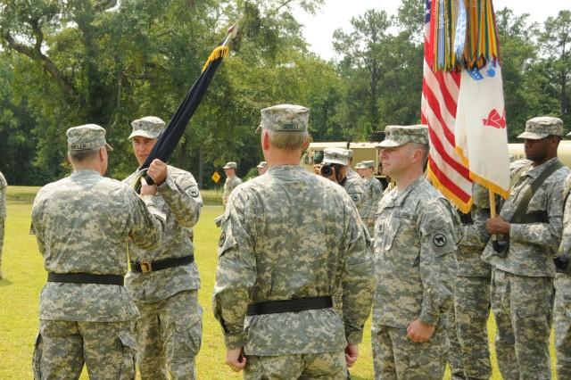 Maj. Gen. Jon. J. Miller; Deputy Commanding General of the U.S. Army Reserve  Command; passes the unit colors of the 81st Regional Support Command to acting commander Brig. Gen. Mark Arnold during a change of command ceremony at Fort Jackson, S.C. The outgoing commander, Maj. Gen. William H. Gerety will take over as commander of the 80th Training Command in Richmond, Va. later this month. The ceremony was held August 19, 2011.  (U.S. Army Reserve photo by SFC Joel Quebec)