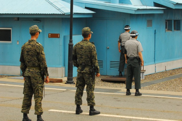 Soldiers with the 3rd Republic of Korea Army (TROKA) stand guard at the Korean Demilitarized Zone August 11.