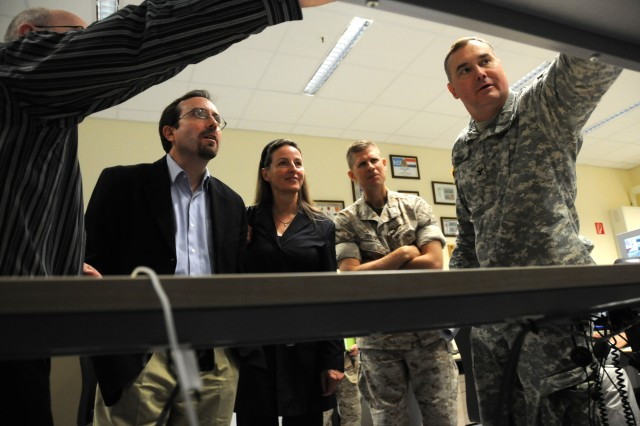 U.S. Army Col. John M. Spiszer, commander of the Joint Multinational Readiness Center, provides a training capabilities brief to U.S. Ambassador to Georgia, John Bass (center) and Gabriela von Habsburg, Georgian Ambassador to Germany during their visit to the JMRC in Hohenfels, Germany on August 19, 2011. (U.S. Army photo by Sgt. Kris Eglin)