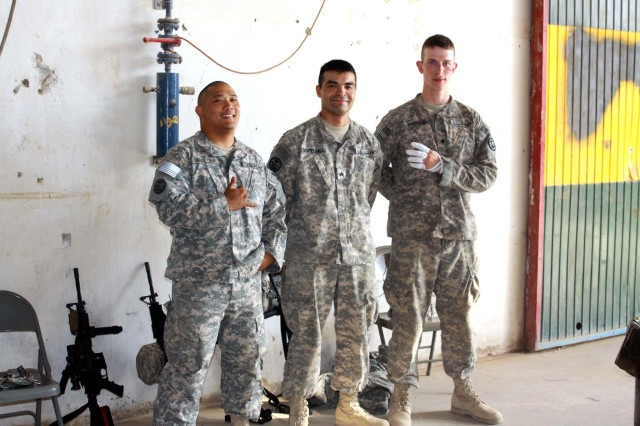 Sgt. Victor Pamplona (left), Sgt. Juan Montelongo, and Spc. Chad Mitschelen, all mine-resistant, ambush-protected vehicle crewmen with Golf Company, 3rd Battalion, 116th Cavalry Regiment, 77th Sustainment Brigade, 310th Expeditionary Sustainment Command, stand together at Joint Base Balad, Iraq. Pamplona, Montelongo and Mitschelen all survived a vehicle-borne improvised explosive device ambush and said their training and the durability of their MRAP saved their lives.