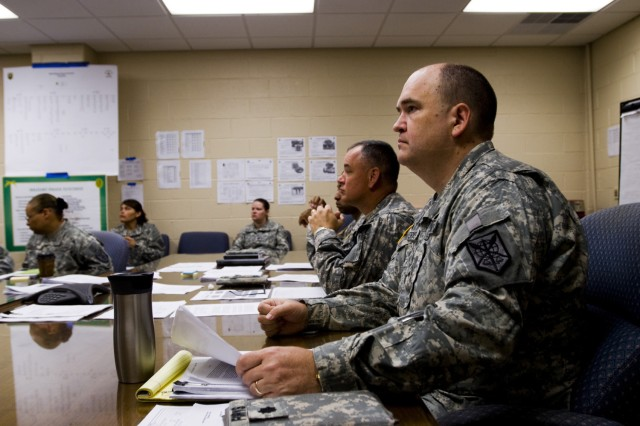 Lt. Col. Matthew Forys (far right) and Lt. Col. Curtis Sauberan (center), both operations officers assigned to the 200th Military Police Command, listens to guidance from Col. Marion Garcia, the command's chief of staff, prior to discussing communications between the Fort Meade, Md., team and 200th MPC Soldiers in Camp Walker, South Korea. The 200th MPC is participating in Ulchi Freedom Guardian 2011 -- a Combined Forces Command exercise involving the ROK, United States and seven United Nations Command sending state nations.