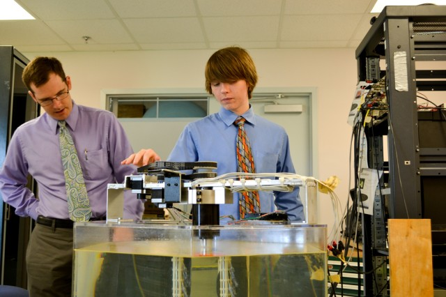 Army Research Laboratory aerospace engineer Chris Kroninger, left, assists summer intern Keith McKinzie during testing of a robotic wing at Aberdeen Proving Ground, Md.