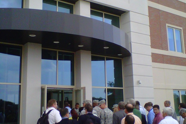 FORT BRAGG, N.C. (August 23, 2011) - U.S. Army Forces Command Soldiers and civilians return to their offices after having evacuated Marshall Hall, the new FORSCOM/U.S. Army Reserve Command headquarters, because of tremors felt here that were caused by a 5.9-magnitude earthquake centered northwest of Richmond, Va. The occasion provided a real-world opportunity to test the building's evacuation procedures.