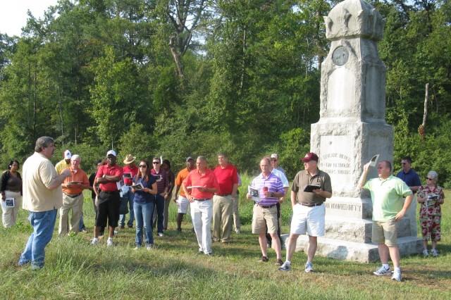 Mike Weitzel (left) ACC Historian, briefs fellow staff riders at the Chickamauga battlefield near Chattanooga, Tenn.