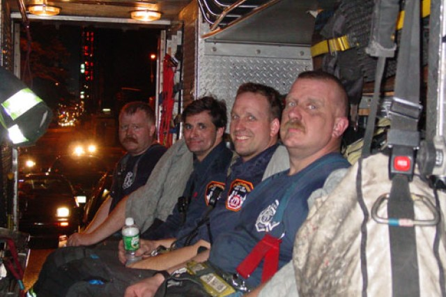 Now-New York City Fire Department Lt. Thor Johannessen (far left) poses with fellow firefighters from Special Operations Company Rescue 1 in their truck. Rescue 1 is responsible for rescuing other firefighters, as well as victims of major disasters, such as a plane crash or a train derailment. The company lost 11 of its 27 members on 9/11, including the company commander and senior lieutenant, after the World Trade Center's North Tower collapsed. Johannessen later joined the New York National Guard, where he is a captain, and has used his search and rescue experience to help victims of the 2010 Haiti earthquake.