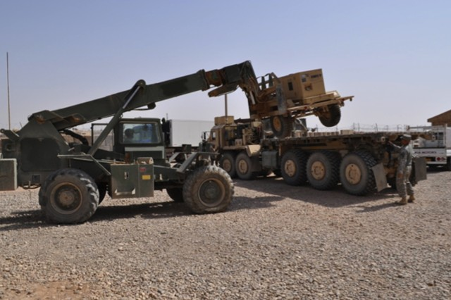 """KIRKUSH MILITARY TRAINING BASE, Iraq """" Soldiers of 1st Battalion, 8th Cavalry Regiment, 2nd Advise and Assist Brigade, 1st Cavalry Division, U.S. Division """" North, load equipment to assist in the transition of Kirkush Military Training Base, Iraq, Aug. 11."""