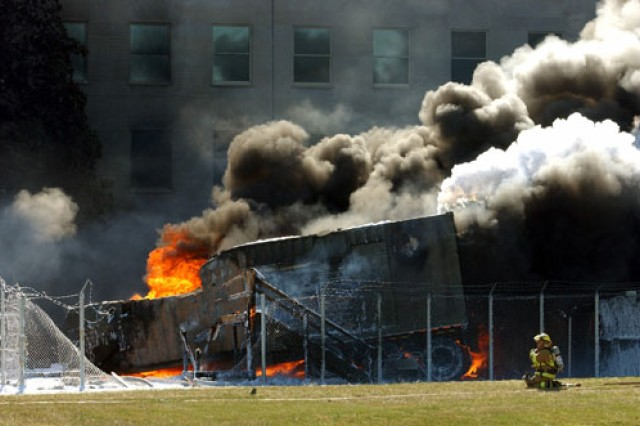 The Pentagon burns moments after a hijacked jetliner crashed into building at approximately 9:30 a.m., Sept. 11, 2001.