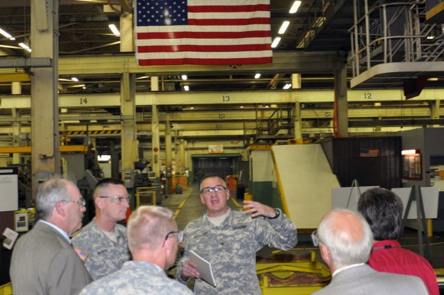 Arsenal Commander Col. Mark Migaleddi, center facing camera, briefs Maj. Gen. Patrick Murphy and his staff.