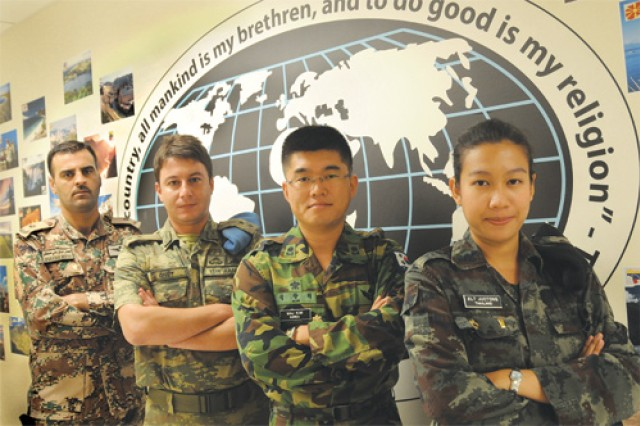 FROM LEFT TO RIGHT) Maj. Jafar Alnizami of Jordan, 1st Lt. Onut Enver of Turkey, Maj. Changhee Kim of South Korea and 2nd Lt. Kamentip Juctong of Thailand represent four of the students from the 52 countries associated with the Army Logistics University.