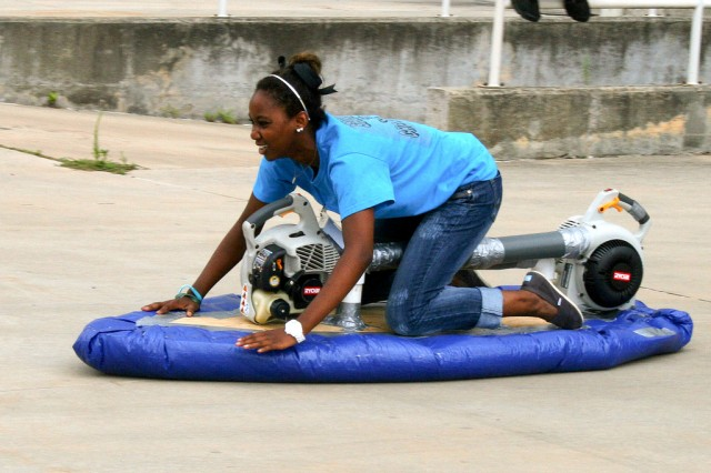 A student rides a hovercraft during the Gains in the Education of Mathematics and Science program at Redstone Arsenal, Ala.
