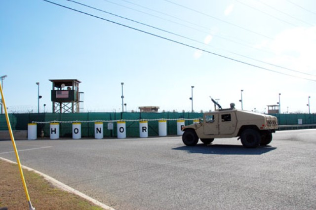 525th Military Police Battalion Soldiers patrol the perimeter of Camp 5, Guantanamo Bay, Cuba. U.S. Army South's 525th Military Police Battalion is charged with providing command, control and operational support to high-risk detention operations at Camp 5.