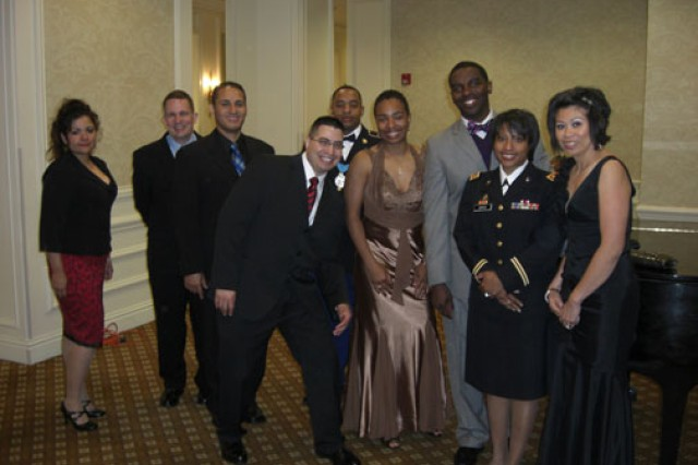 Staff Sgt. Tiffany Skelton is surrounded by her battle buddies from Headquarters and Headquarters Company, Human Resources Command-St. Louis at a commemorative ball in April 2010. From left to right: Staff Sgt. Cynthia Garza, Sgt. 1st Class Joseph Best, Master Sgt. Dion Acevedo, now-Master Sgt. Julio Veja, 1st Sgt. Michael Gaston, Skelton, Capt. Edgar Borgella, Maj. Daphne D. Davis and Staff Sgt. Renayln Nelson.