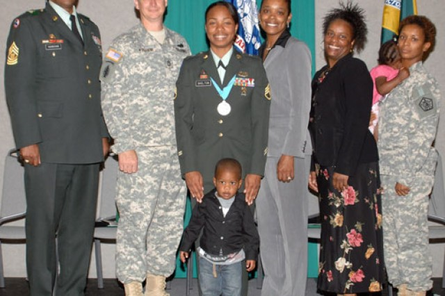 Staff Sgt. Tiffany Skelton poses with friends and family after her induction into the Sergeant Audie Murphy Club, which is a leadership organization for noncommissioned officers. Skelton nearly committed suicide a few months later.