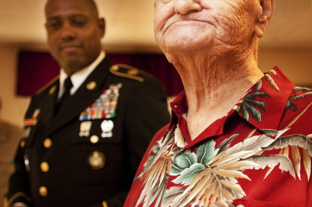 Frederick Spellman, a World War II veteran from Maine who now lives in Natick, received the State of Maine Silver Star Honorable Mention Award on Aug. 24. In the background is Command Sgt. Maj. Brian Warren of U.S. Army Garrison-Natick.