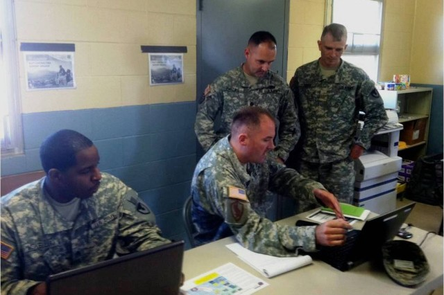 (Left to Right) Staff Sgt. Aaron Mckellum and Maj. Seth Blakeman discuss their contracting support concept with Lt. Col. Jeffery Phillips, 904th CCBN commander, and Maj. Anthony Gibbs, battalion S-3 officer.