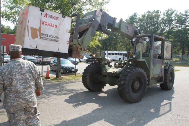 Virginia National Guard Soldiers in Sandston prepare for possible duty in response to Hurricane Irene by unloading pallets of cots and Meals Ready to Eat. The Virginia National Guard has been authorized to bring up to 300 personnel on state active duty for possible missions including high water transport and light debris removal.
