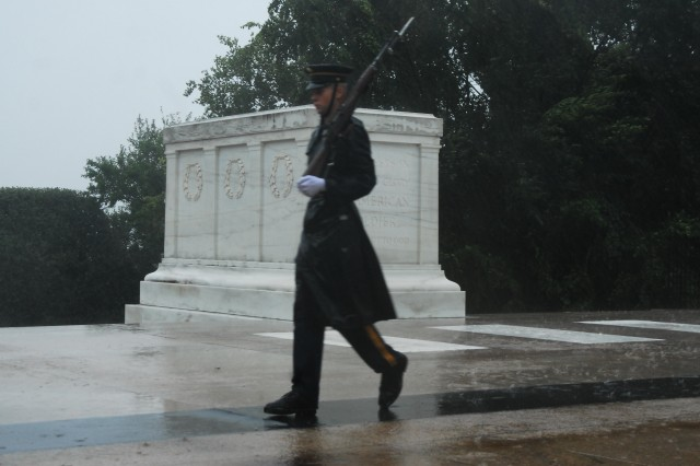ARLINGTON, Va. -- A 3rd U.S. Infantry Regiment (The Old Guard) Soldier walks his tour in humble reverence past the Tomb of the Unknown Soldier at Arlington National Cemetery during Hurricane Irene.