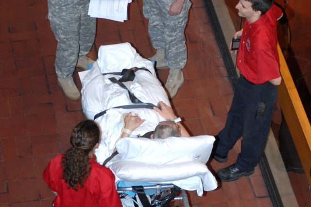 Army medical personnel check a inpatients records before being rolled out to an awaiting Ambulatory vehicle and transported from Walter Reed Army Medical Center in Washington, D.C., to the National Naval Medical Center in Bethesda, Md., Aug. 27, 2011. Officials moved up the transfer date by one day to avoid the worst effects of Hurricane Irene along the East Coast.