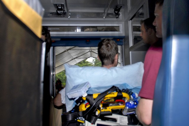 The last inpatient from Walter Reed Army Medical Center in Washington, D.C., sits in an ambulance before transport to the National Naval Medical Center in Bethesda, Md., Aug. 27, 2011.