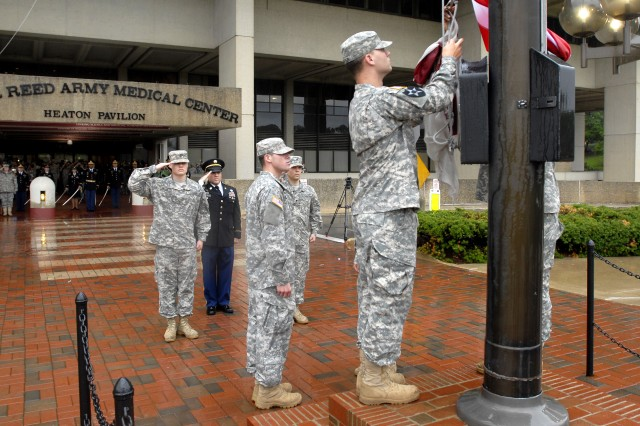 Army Command Sgt. Maj. Rodolfo R. Delvalle and soldiers salute as members of the honor guard lower the U.S. flag for the final time at Walter Reed Army Medical Center in Washington, D.C., Aug. 27, 2011. Delvalle is Walter Reed's command sergeant major.