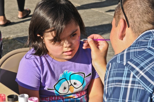 Eight-year-old Destiny Onate has a small person painted on her face Aug. 26, 2011, at the Chapel Support Center on McChord Field, Wash., during a back-to-school carnival event for families with children enrolled in the Exceptional Family Member Program. The event provided entertainment for the kids and an abundance of information for the adults from a wide array of support services on Joint Base Lewis-McChord, Wash.