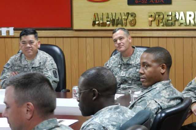 Brig. Gen. James Dickinson (center) listens to a mission brief from the 6th Battalion, 52nd Air Defense Artillery.
