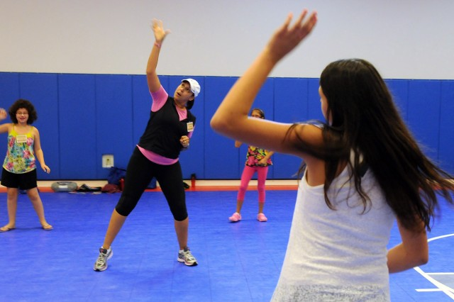 "Aerobics instructor Julie Yates leads young girls in an exercise routine during ""Simply Sensational."""