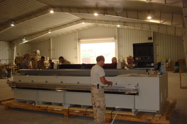 Members of the U.S. Army Research, Development and Engineering Command Field Assistance in Science and Technology Center unload equipment at Bagram Airfield, Afghanistan.