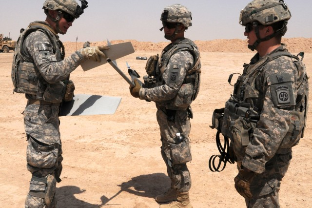 Paratroopers with 1st Battalion, 325th Airborne Infantry Regiment, of the 82nd Airborne Division's, 2nd Advise and Assist Brigade reassemble the unmanned aircraft before launching it into the sky, during training at Camp Fallujah, Iraq, Aug. 23, 2011. With a long history of supporting U.S. military operations in Iraq, the 82nd Airborne Division's, 2nd Advise and Assist Brigade and it's paratroopers are enabling the withdraw of U.S. military forces from Iraq.